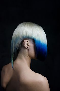 Conceptual blue to white ombre hair dye and cut.