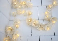 String of lights decorated with coffee filters.