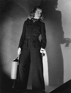 30s 40s war era vintage fashion sportswear workwear pants designer Maison Schiaparelli - Key dates 1939 Creation of a jumpsuit with a large zips and maxi pockets (intended to hold the equivalent of a handbag) and suits with integrated bags to pre-empt the air raids.