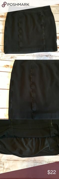 Vince Camuto Black Mini Skirt Vince Camuto black mini skirt with faux leather strips. Zips up in the back. No rips, stains or tears. Fully lined. Vince Camuto Skirts Mini