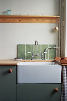 A Vintage-Inspired Apartment in Hackney from Abel Sloane and Ruby Woodhouse of 1934 - Remodelista, A traditional butler sink and faucet sourced from a company in the north of England and a custom backsplash of green tile originally salvaged from a c. Living Room Red, Living Room Interior, Interior Modern, Interior Design Kitchen, Modern Luxury, Küchen Design, Home Design, Design Ideas, Design Inspiration