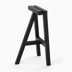 Timber stool from the black collection by Nendo for K%