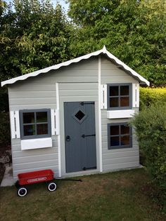 Grey wooden playhouse