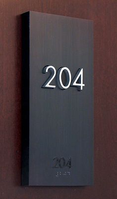 The Montana Residence, Signage hotel room number by Gatemark Design