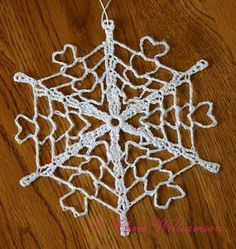 Chris Williamson's Castaway Snowflake - this snowflake from Snowcatcher.net looks different depending on how it's pinned/blocked. Very neat!!