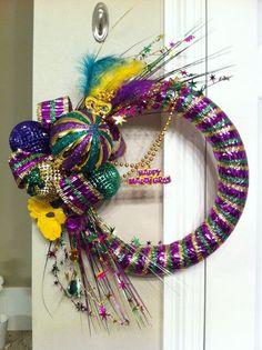 heather - My Mardi Gras wreath. I made two of them for my office doors. Mardi Gras Wreath, Mardi Gras Beads, Mardi Gras Party, Holiday Wreaths, Holiday Ornaments, Mardi Gras Centerpieces, Mardi Gras Decorations, Mardi Gras Costumes, Diy Wreath