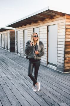 Fur coats are a must have this fall. Wear yours with black jeans or leggings like Janni Deler to keep all attention on your statement fur piece. Fur: DryLake, Top: Bershka, Leggings: From Spain, Shoes: Jennie-Ellen.