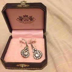 Juicy couture cubic zirconia earrings Still in box. Only worn once or twice. Box has some wear to it. Earrings are very sparkly and go perfect for dressing up :) offers accepted Juicy Couture Jewelry Earrings