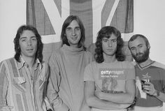 British progressive rock group Genesis posing in front of a union jack flag, 4th September 1975. Left to right: guitarist Steve Hackett, bassist Mike Rutherford, keyboard player Tony Banks and singer/drummer Phil Collins.