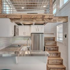 Lofts have become an almost essential component of tiny house living, but few offer the headroom. Tiny House Movement // Tiny Living // Tiny House on Wheels // Tiny House Kitchen // Tiny Home Kitchen / Tiny Home Tiny House Loft, Tiny House Living, Tiny House Plans, Tiny House On Wheels, Tiny Loft, Tiny House With Stairs, Tiny Home Floor Plans, Tiny House Trailer Plans, Tiny Mobile House