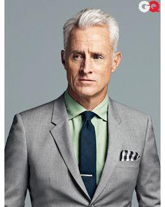 grey suit, green shirt, blue-green tie, checkered pocket square | John Slattery