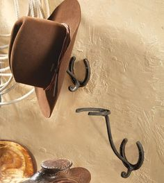 Horseshoe Cowboy Hat Rack - A Black Forest Decor Exclusive - With a rustic horseshoe and scroll design, this cast iron wall-mount rack adds ranch style to your entryway. Measures 3 x 8 x 11 ~ Horseshoe Projects, Horseshoe Crafts, Horseshoe Art, Horseshoe Ideas, Horseshoe Boot Rack, Lucky Horseshoe, Cowboy Hat Rack, Cowboy Hats, Horse Barns