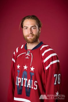 Washington Capitals goalie Braden Holtby shows off the Caps' 2015 Bridgestone NHL Winter Classic® jersey