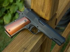 1911 | Just viewing this awesome looking weapon is like taking a step back in time.