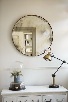 Circular rusted iron mirror fitted with our highly distressed antiqued mirror…