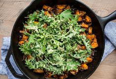 An easy gluten-free and vegetarian meal made from pantry staples, this Roasted Sweet Potato, Black Bean, and Fried Quinoa Skillet is hearty and satisfying.