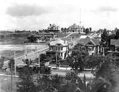 """This circa 1892 photo shows us a residential stretch of Seventh Street at Lucas Avenue, not far from downtown Los Angeles. It's a block south of what was once called Orange Street before Henry Gaylord Wilshire started developing it into Wilshire Blvd in the late 1890s. In the background, we can also see one of those 150-foot electric light """"Moon Towers"""" featured in yesterday's photo."""