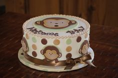 Monkey baby shower cake with polka dots