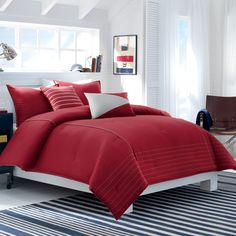 The Nautica Mainsail bedding set adds a modern touch to any bedroom decor. Featuring a red solid pattern, the comforter reverses to a striped design. This set also includes two standard shams and an optional Euro sham that is sold separately. Coastal Bedding, Luxury Bedding, Coastal Curtains, Coastal Rugs, Modern Coastal, Coastal Farmhouse, Coastal Cottage, Coastal Style, Coastal Decor