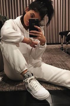 Kylie Jenner wearing Supreme x Air Jordan 5 Sneakers and Vianel Charcoal Croc Iphone Case