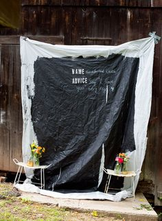 This DIY chalkboard photo backdrop doubles as a guestbook! #wedding #DIY