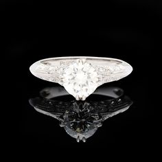 Platinum ring features a GIA 1.30 carat round brilliant cut diamond accented with 34 round brilliant diamonds totaling 0.53 carats.  Gorgeous diamond ring for that special someone.   CLICK PLAY ICON TO WATCH VIDEO
