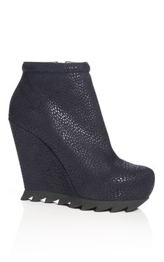 Shop Camilla Skovgaard Midnight Saw Sole Ankle Wedge Bootie at Moda Operandi