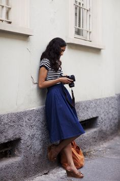 Create a classic look in a striped top, long A-line skirt and simple wedges.
