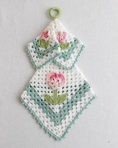 white and blue granny square potholder