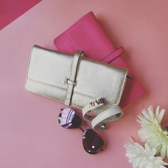 Pretend to be #spring!!!!!  Top to bottom: Pink and silver color #Annabelingall #clutch long wallet.  #CCSkye - white - double wrap portico #bracelet.  #Ray-Ban #Aviator - color: #lavender.  All presented by your online wardrobe [#BOU7IQUE]