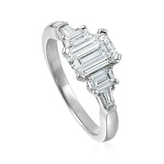 5 stone step emerald cut engagement ring