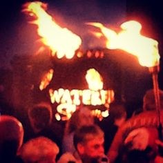 The custom WaterFire Sharon, PA Fire Globe™ is ablaze on the State Street Bridge.