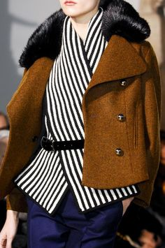 layers. Grab your widest scarf and wrap around your chest then belt it. Add a light weight blazer instead