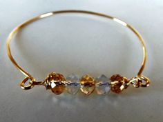 Crystals bangle handmade with 5 Czech crystals and 16 ga gold filled wire.  This bangle has to be slipped over your hand.  I can make your size on order.
