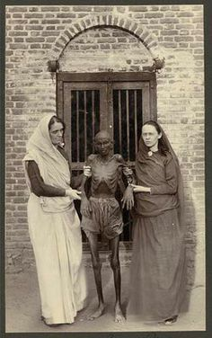 Western Women Pose with a Famine Victim, India, c. 1900