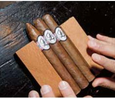 Monogrammed cigars from Jackie and Jake Long wedding at the Ritz Carlton in Naples. Wedding by Tiffany Cook Events