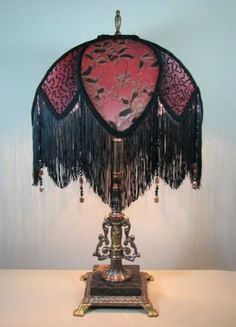 This is a wonderful vintage lamp that I refinished, rewired and created a  handsewn Victorian style lamp shade for. The techniques I used for creating the lamp shade include hand stitching...