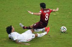US midfielder Jermaine Jones (L) vies with Portugal's midfielder Joao Moutinho (R) during a Group G football match between USA and Portugal at the Amazonia Arena in Manaus during the 2014 FIFA World Cup on June 22, 2014.