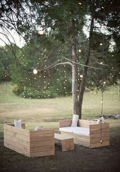 String lights + box benches. This would be cute for an outdoor wedding. It would probably be pretty easy and cheap to build, especially if you recycled old pallets.