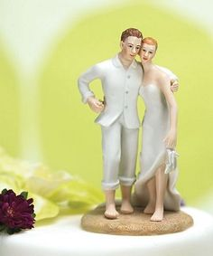 Beach Bride and Groom Wedding Cake Topper - Complement your romantic beach setting with a beautifully crafted and equally enchanting cake topper. Exquisitely detailed down to the heart drawn in the sand with her delicate finger. Hand painted porcelain.  The hair color of each figure can be customized!
