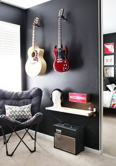 Guitar Hanger - painting the wall black with bright guitars! great contrast...not sure about this for my basement jam room though