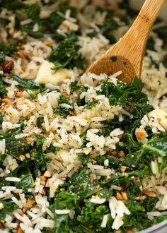 Close up of Garlic Butter Rice with Kale recipe in a pot with a wooden spoon, fresh off the stove ready to be served. I save this for the idea but I will do it all in my instant pot Side Dish Recipes, Veggie Recipes, Vegetarian Recipes, Cooking Recipes, Healthy Recipes, Recipes With Kale, Cooked Kale Recipes, Chicken And Kale Recipes, Cooking Kale