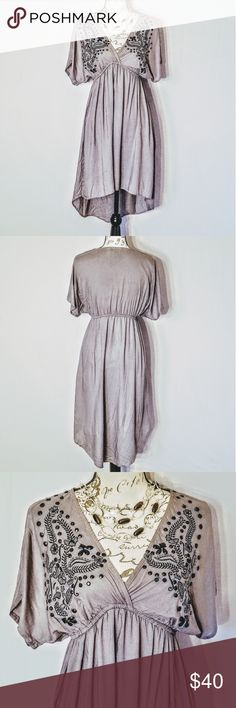 """🌻 NEW Boho Beaded Swing Dress *NWT *Boutique Dress *Silver Colored Boho Style Swing Dress *100% Rayon *Dolman Sleeves *High Low Hemline *Black Beading and Embroidery Adorn the Front *Deep V Front *Loose Elastic Band just Below Bodice *Contemporary Size Large: B 40"""" L 35"""" (in front) *Very Flattering Cut 🌼Beautiful Little Dress🌼 Angie Dresses High Low"""