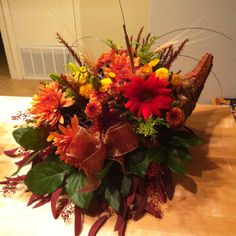 Thanksgiving floral arrangement- I reuse the same cornucopia every year and buy flowers from Costco :-)