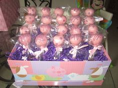 Baby shower cake pops! it's a girl I used a photo memory box from Ross for 2$ and foam on the bottom.
