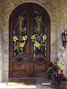 Wreaths are hung with ribbon on the tall doors. http://www.hgtv.com/decorating-basics/10-christmas-wreaths/pictures/page-9.html?soc=pinterest