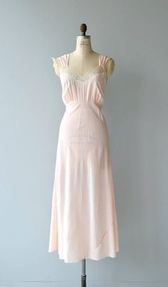 Vintage late 1930s, early 1940s pale pink bias cut rayon nightgown with wide shoulders and net and embroidered bodice. ✂-----Measurements fits like: large/extra large bust: 43 waist: 36 hip: 49 length: 57 brand/maker: Josie condition: very good, faint spots near hip to ensure a good fit, please read the sizing guide: http://www.etsy.com/shop/DearGolden/policy ✩ more lingerie | swim ✩ https://www.etsy.com/shop/DearGolden?ref=hdr_s...