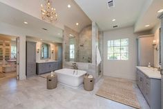 5444 Candlewood Houston, TX Photo Master bath with elegant his and hers vanities, large and elegant shower, antique European chandelier, 2 water closets. Love this on a smaller scale 😊 Master Bathroom Layout, Luxury Master Bathrooms, Bathroom Design Luxury, Large Bathrooms, Dream Bathrooms, Beautiful Bathrooms, Modern Bathroom, Bathroom Ideas, Mansion Bathrooms