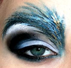 dramatic eyeshadow in blue, white, black and gold - I have absolutely no use for this, but it looks really cool.