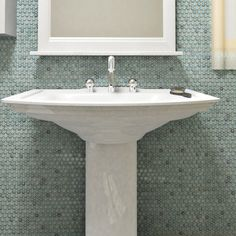 Create a tranquil atmosphere in your bathroom with these porcelain tiles from SomerTile, which feature a mosaic design of penny-sized porcelain pieces in a refreshing marine color to mesh perfectly wi